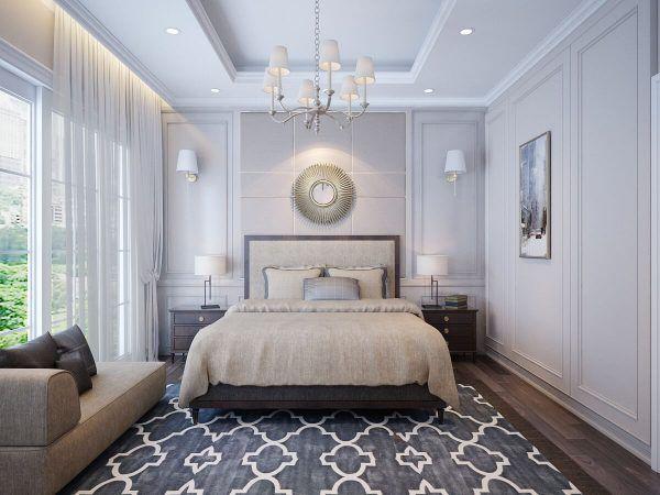 Giường ngủ bọc nệm cao cấp nằm ở trung tâm của căn phòng